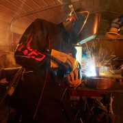 Black Stallion welders jacket black with flames in action