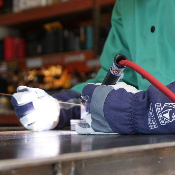 Black Stallion Premium TIG welding glove action shot